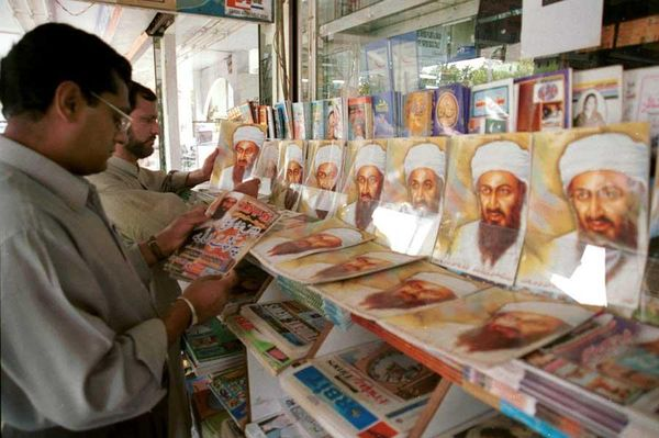 Pakistani-shoppers-browse-magazines-with-a-picture-of-osama-bin-laden-on-the-cover-at-a-book-stand-in-the-center-of-islamabad-pakistan-days-after-the-us-attacks-sept-20-2001